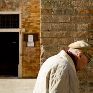 Venice, Italy - old man passing by, color photo