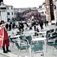 Venice-gentleman dressed in 18th century costume on the cellphone in Venice, color landscape photo