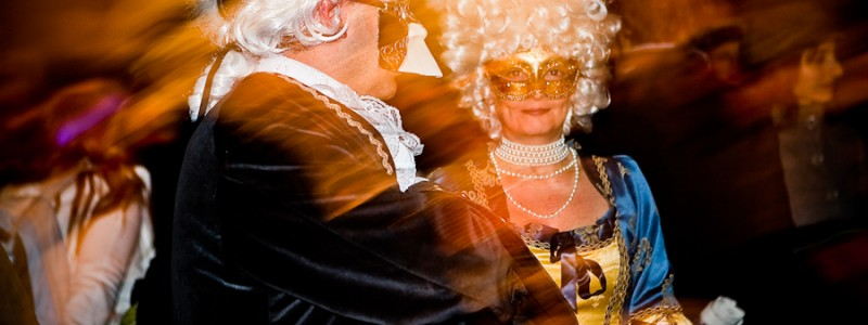Venice-Couple dressed in costume for Carnival in St. Mark's square, color landscape photo