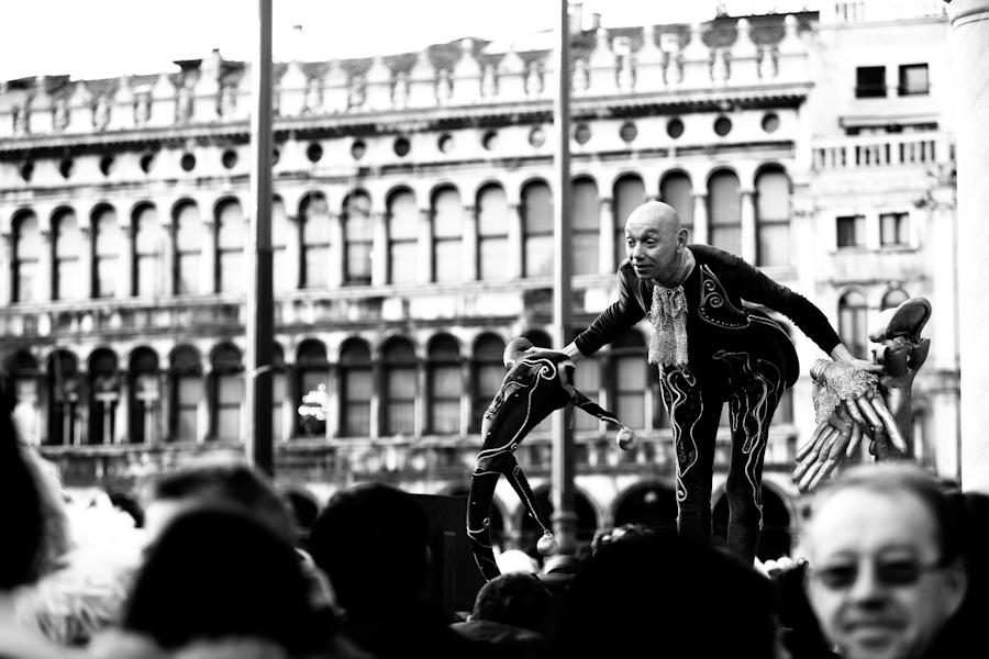 Venice-Actor in carnival costume in St. Mark's square, color landscape photo