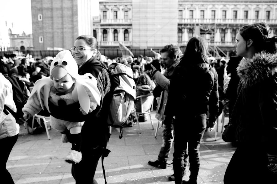 Venice-kid in carnival costume in St. Mark's square, black & white landscape photo