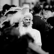 Venice - Man in white carnival costume in St. Mark's Square, black & white landscape photo