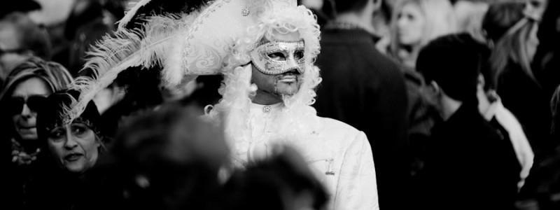 Venice - Man in white carnival costume in St. Mark's Square, black & white landscape photo