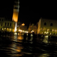 Venice - St. Mark's Basin at night viewed from motor boat, color landscape photo