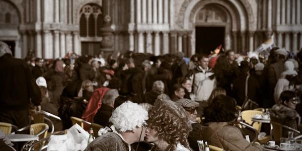 Venice-couple in carnival costume kissing in St. Mark's square, color portrait photo