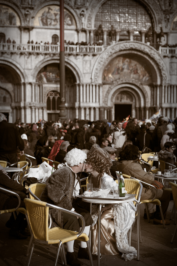 Venice-couple in carnival costume kissing in St. Mark's square, color portrait photo
