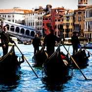 Venice, Italy - gondolas in Grand Canal nearby Rialto Bridge, color photo