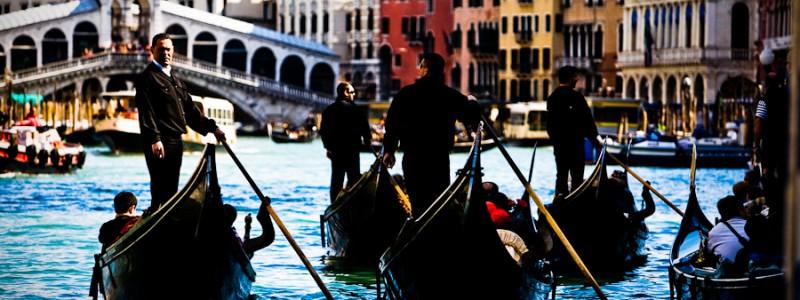 Venice, Italy - gondolas in Grand Canal nearby Rialto Bridge, color photo