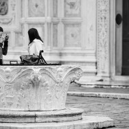 Venice, Italy - people in San Zaccaria square, black and white photo