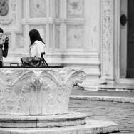 Venice, Italy - people in San Zaccaria square, black and white photo