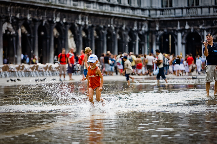 Venice - kids playing with high-water in St. Mark's Square, color landscape photo