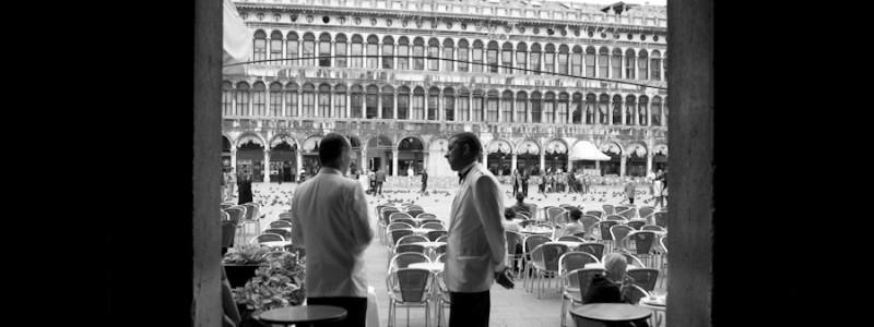 Venice - waiters at Cafe Florian in St. Mark's Square, black and white landscape photo