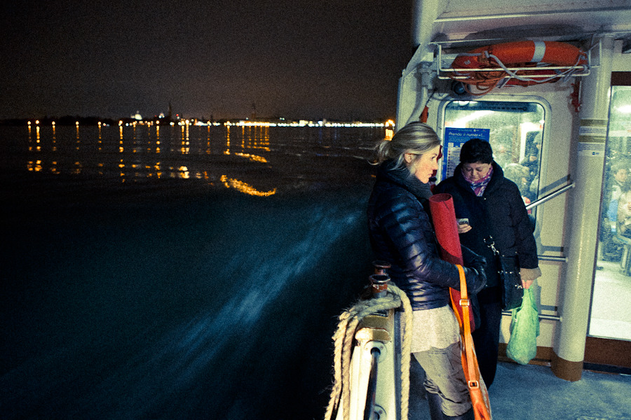 Venice - night photo on a waterbus with St. Mark's lights in background, color landscape photo
