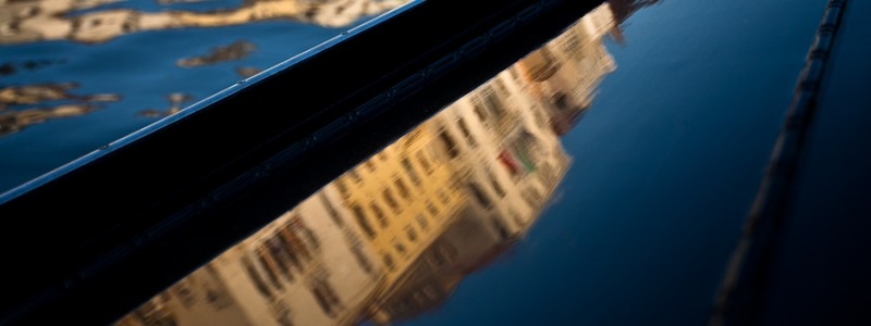 Venice - reflections of Grand Canal palaces over the side of a gondola , color landscape photo
