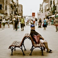 Venice - old man sitting on a bench in Via Garibaldi, color landscape photo