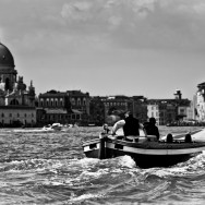 Venice - motorboat with church of Salute in the background, black and white photo
