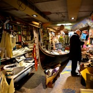Venice - gondola used as bookshelf inside a bookstore, color landscape photo