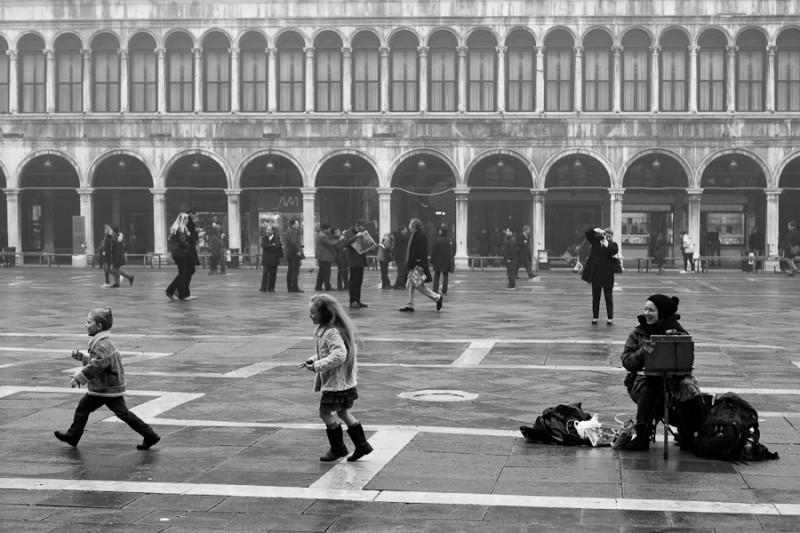 Venice - painter in St. Mark's square, black and white landscape photo