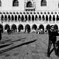 Venice - gondolier and tourist in front of Doge's Palace