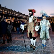 Venice - couple in carnival costume in St. Mark's square, color landscape photo