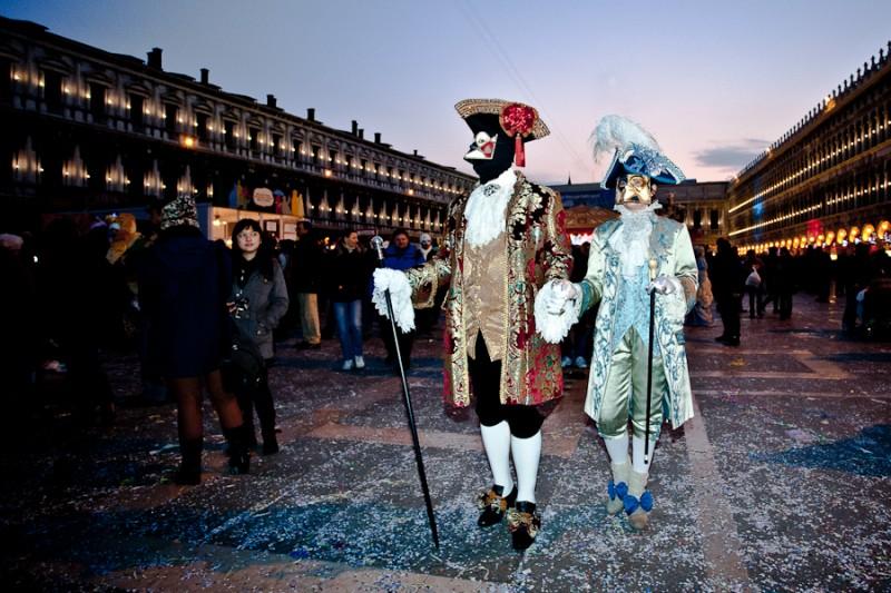 Venice - couple in carnival costume in St. Mark's square, color landscape photo