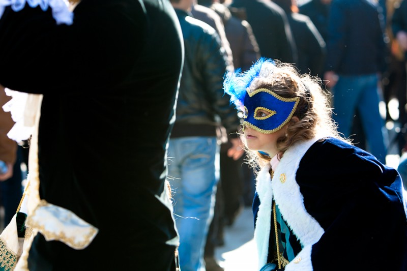 Venice - young girl in carnival costume, color landscape photo