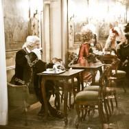 Venice - people in costume at Caffe Quadri in St. Mark's square, landscape color photo