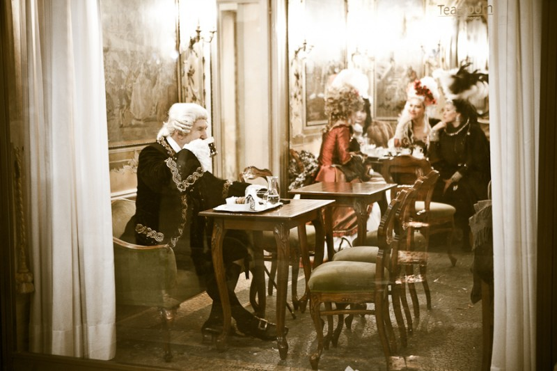 Venice - people in costume at Caffe Quadri in St. Mark's square, landscape color photo