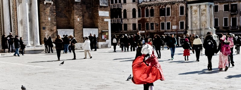 Venice - boy in carnival costume in Campo S. Giovanni e Paolo, color landscape photo