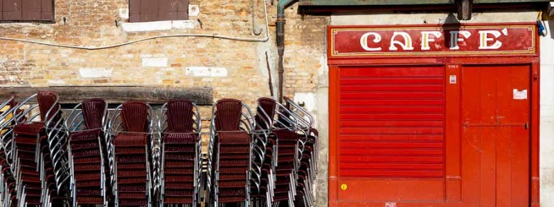 Venice - stacked chairs outside a cafe in S. Margherita square, color landscape photo