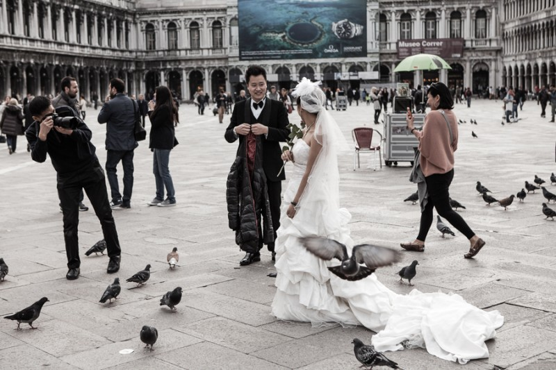 Venice - newlyweds from Asia take a walk in St. Mark's square, color landscape photo