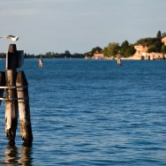 Venice - lagoon at sunset with S. Nicolò abbey in the background, color landscape photo