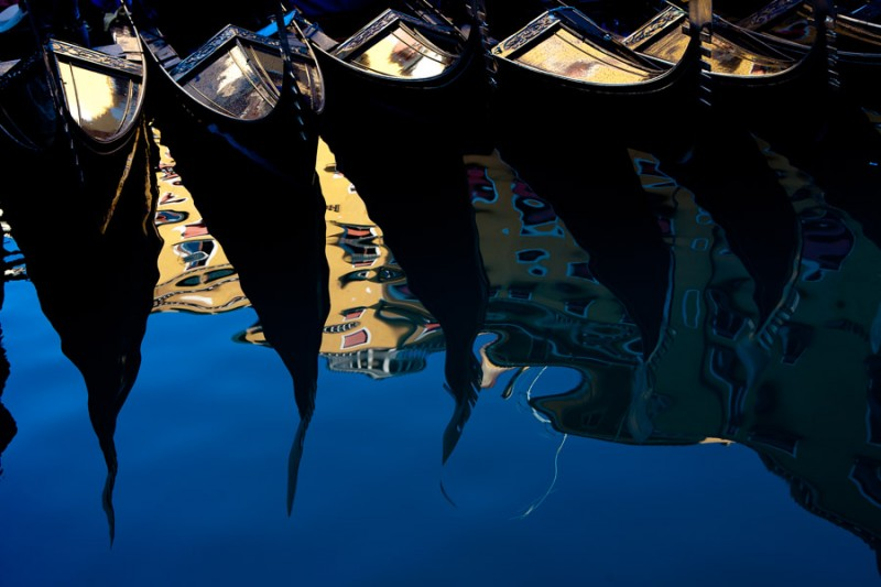 Venice - moored gondolas reflect on the water, landscape color photo
