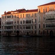 Venice - Ca Foscari palace in Grand Canal at sunset, color landscape photo