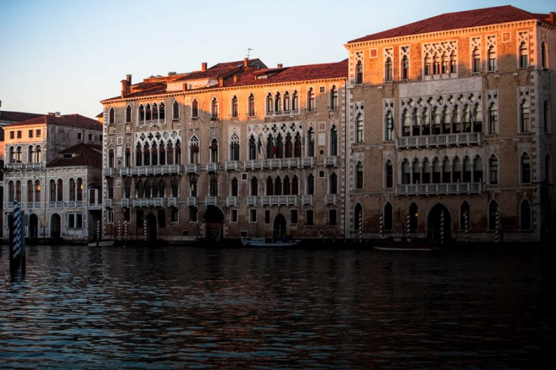 Venice - Ca Foscari palace in Grand Canal at sunset, color landscape photo