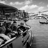 Venice - tourists on waterbus approaching Rialto Bridge, black and white landscape photo