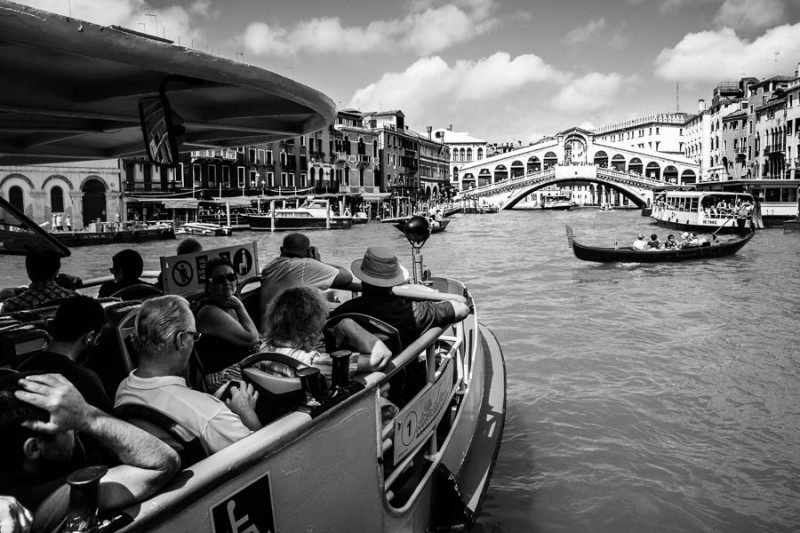 Venice - tourists on waterbus approaching Rialto Bridge, black and white landscape photo