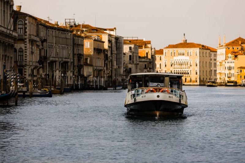 Venice - waterbus in Grand Canal at dawn, color landscape photo