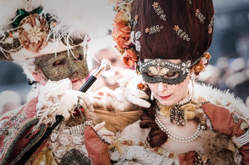 Venice - couple in carnival costumes at St. Mark's square