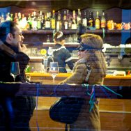 Venice-couple chatting at the cafè during Carnival, color landscape photo